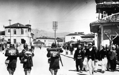 Italian_soldiers_passing_Albanians,_7_April_1939 Italian invasion of Albania Fascist