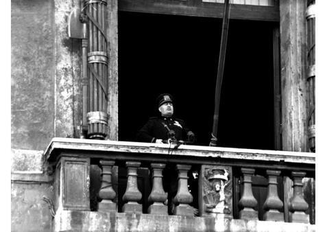 Mussolini_DOW_10_June_1940 Italian leader Benito Mussolini delivering his war declaration on France and Great britain from the Palazzo Venezia Balcony in Rome. Fscist dictator.