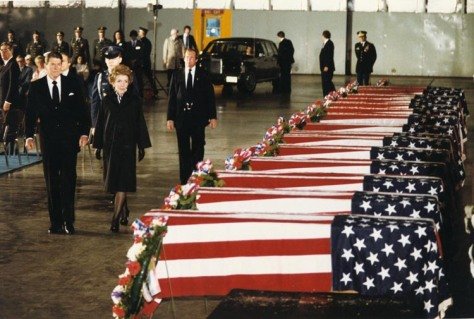 President Ronald Reagan and First Lady Nancy Reagan pay their respects and tribute to the 13 American civilian and 4 U.S. military personnel victims of the embassy bombing. Beirut. Leban