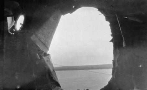 HMS_Castor_damage A photograph taken from inside the hull of the light cruiser HMS Castor after the Battle of Jutland showing a large shell hole. Her crew suffered ten casualties during