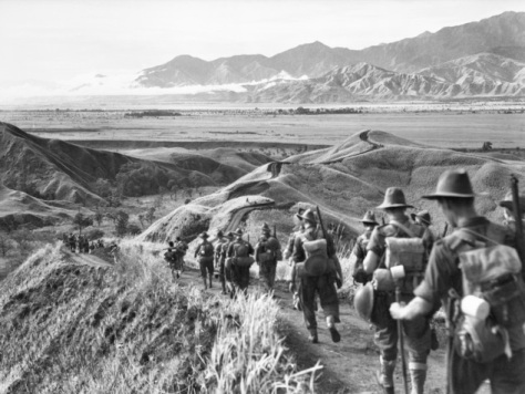 AWM_060483_Australian_21st_Brigade_troops_Ramu_Valley_1943 Soldiers from the Australian 21st Brigade move down from the Finisterre Range into the Ramu Valley 9th November 1943