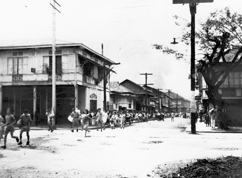 Citizens of Manila run for safety from suburbs burned by Japanese soldiers. Philippines. 10th February 1945.