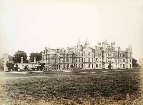 Exterior of Burghley House, Cambridgeshire, viewed from the north-west.. Photograph taken on the 31st of January 1887.