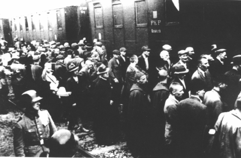 First_transport_to_Auschwitz_(Tarnów_-_14th_June_1940) Prisoners from the first transport to KL Auschwitz at the train station in Tarnów. The transport was composed mostly of Polish po