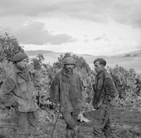 Officers from the 2nd Battalion, Parachute Regiment resting near Beja after returning from a drop on Depienne. From left to right Captain Stark, Lieutenant Braylet and Major Ashford. 26t