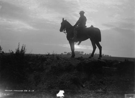 The_Battle_of_the_Somme,_July-november_1916_Q720 A British mounted sentry outside Cafe Jordan, Mailly Maillet, 28th June 1916. The Battle of the SOmme.