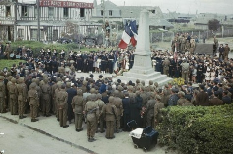 Bastille_Day_in_Courseulles,_Normandy,_14_July_1944_TR2000French, British and American troops join with local inhabitants of Courseulles-sur-Mer in the ceremony at the War Memorial