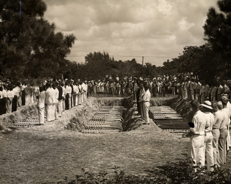 Burial_of_1935_hurricane_victims_at_Woodlawn_Cemetery,_Miami,_FL 8th September, 1935, burial with military honors of a reported 116 victims of the 1935 Labor Day hurricane at Woodlawn Pa