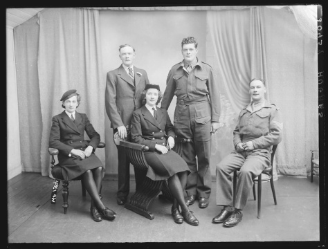 Creator-_H__Allison_&_Co__Photographers_(6174941465)Hughes family of 129 Railway Street, Armagh, County Armagh. Portrait. 19th July 1945.