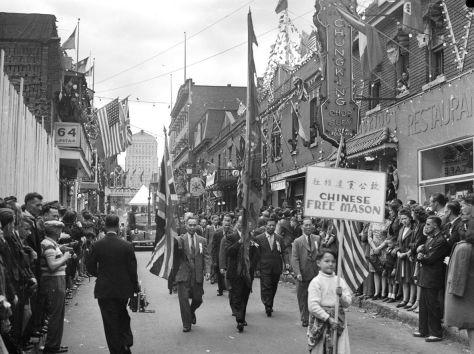 Parade_in_Montreal's_Chinatown Montreal's Chinese community celebrates V-J Day and the official surrender of Japan with a parade in Chinatown. 2nd September 1945.