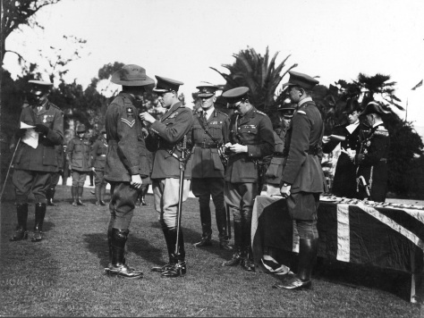 The Prince of Wales (the future King Edward VIII) presents military awards during his visit to Adelaide, South Australia on the 12th of July, 1920. Corporal Arthur Sullivan.
