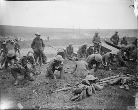 The_Battle_of_the_Somme,_July-november_1916_Q3980 Battle of Bazentin Ridge. British troops digging themselves in by using entrenching tools, Mametz Wood, 17th July 1916.