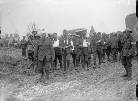 The_Battle_of_the_Somme,_July-november_1916_Q811Wounded soldiers coming in from the advanced dressing station at Bernafay Wood, 19th July 1916.