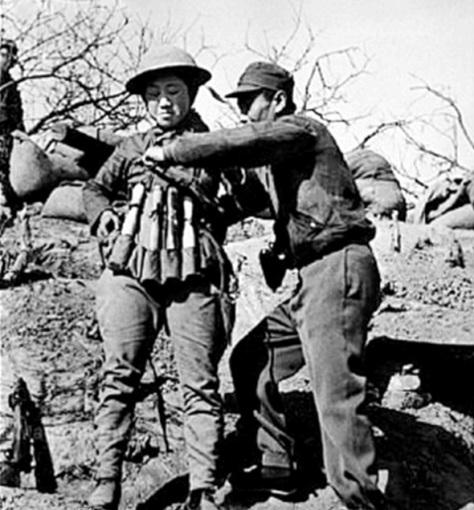 Chinese_infantry_soldier_preparing_a_suicide_vest_of_Model_24_hand_grenades_at_the_Battle_of_Taierzhuang_against_Japanese_TanksThe Battle of Taierzhuang, part of the Second Sino-Japanese