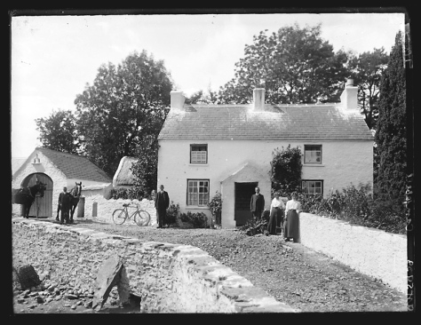 Ireland Creator-_H__Allison_&_Co__Photographers_(6021458203)Campbell family of Tivnacree, Derrynoose, County Armagh. Three men and two women outside a country house with a horse and bicy