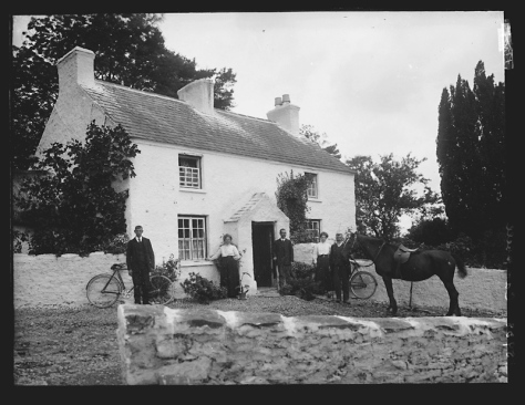 Ireland Creator-_H__Allison_&_Co__Photographers_(6022012160)Campbell family of Tivnacree, Derrynoose, County Armagh. Three men and two women outside a country house with a horse and bicy