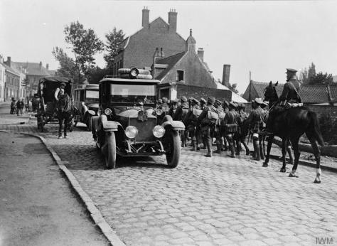 The_Battle_of_the_Somme,_July-november_1916_Q952The Royal cars pass through a village from Chateau Bryas to Franvillers, passing a battalion of the Worcestershire Regiment on the march,