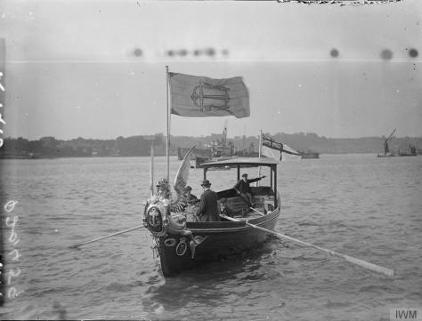 The_Royal_Navy_in_Britain,_1919-1939_Q20459The Admiralty Barge at Chatham flying the Admiralty Flag and White Ensign, 1st August 1919,