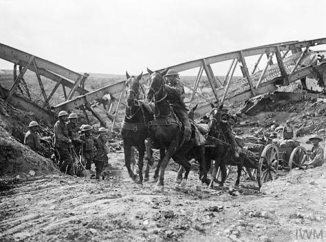 Battle of the Canal du Nord. British Army. A Horse team of the Royal Field Artillery pulling an 18 pounder field gun up the slope of a cutting through the bank of the Canal du Nord, near