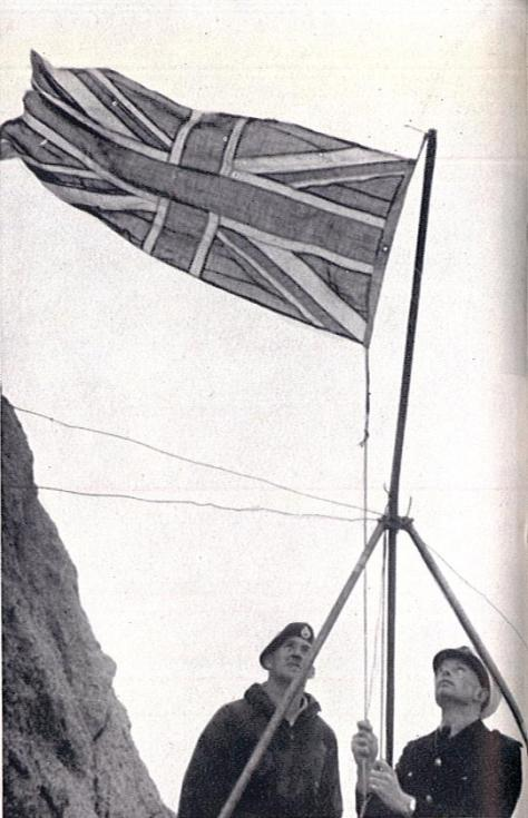 Lt. Cdr. Scott RN raises the Union Flag over Rockall on 18th September 1955, with the words, In the name of Her Majesty Queen Elizabeth the Second, I hereby take posession of this Island