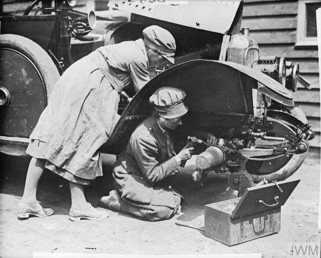 THE WOMEN'S ARMY AUXILIARY CORPS ON THE WESTERN FRONT, 1917-1918. Fitters of the WAAC at work on a car at Etaples, 7 July 1918.