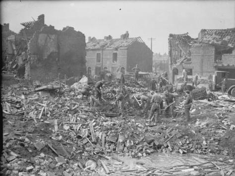 Air_Raid_Damage_in_the_United_Kingdom_1939-1945_H8138 British troops of Western Command clearing up bomb damage in Birkenhead, Cheshire, 15 March 1941. Second World War World War Two