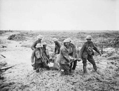 Battle of Pilckem Ridge 31 July - 2 August stretcher bearers struggle in mud up to their knees to carry a wounded man to safety near Boesinghe on 1 August 1917 First World War