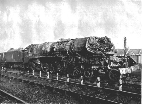 The scene looking south over the aftermath of the Harrow and Wealdstone train crash on 8 October 1952. The badly damaged locomotive of the Perth express train No. 46242 Coronation Class