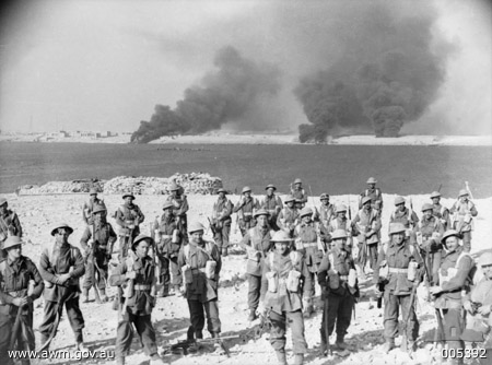 Tobruk Libya 22 January 1941. Members of C Company Australian 2-11th Infantry Battalion having penetrated the outer defences of Tobruk, assemble on the south side of the harbour after at