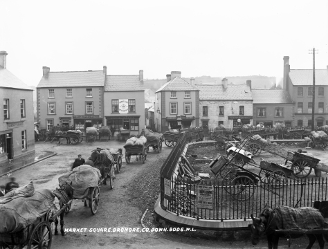 Would_have_been_perfect_if_the_Butcher's_Shop_was_called_Hazlett!_(9553954028)Very patiently queueing horses at the Market Square in Dromore, Co. Down. Ireland Edwardian Northern Ireland