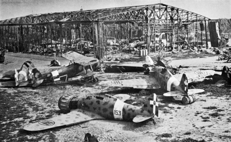 Wrecked_Italian_aircraft_at_Tripoli_1943Wrecked Italian Fiat CR.42 and G.50 aircraft at Castel Benito airport, Tripoli, Libya, in 1943. 10th March 1943. Second World War. World War Two.