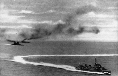 A heavily retouched Japanese photograph of HMS PRINCE OF WALES (upper) and REPULSE (lower) after being hit by Japanese torpedoes on 10 December 1941, off Malaya. A British destroyer can