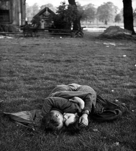 American soldier and his English girlfriend on lawn in Hyde Park, London, 1944. Photograph By Ralph Morse.