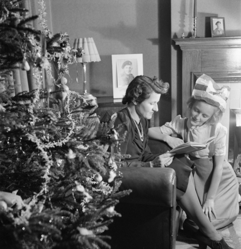 Christmas_Party_For_Trooper_Devereux's_Daughter-_Christmas_in_Wartime,_Pinner,_Middlesex,_December_1944_Mrs Devereux and her 12 year old daughter Jean sit quietly together beside the Chr