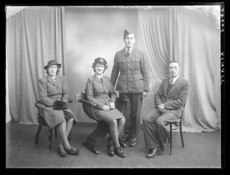 Creator-_H__Allison_&_Co__PhotographersThe Rynatt family of Northern Ireland. Family portrait 9th November 1944. The family members are dressed in military clothing, as Northern Ireland