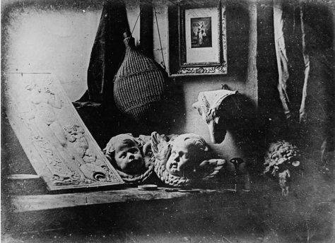 Daguerreotype_Daguerre_Atelier_1837Still life with plaster casts, made by Daguerre in 1837, the earliest reliably dated daguerreotype photograph.
