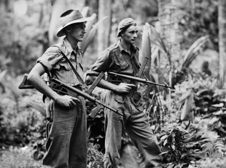 New Britain. 4 April 1945. Private Leon Ravet of Parramatta, NSW Pte Bernard Kentwell of Cronulla, NSW, on patrol duty with their Owen sub machine guns. Both men served with the 19th Bat