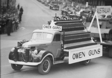 Owen_Guns_Christmas_ParadeChristmas parade 1942 A display of Owen guns, invented and manufactured in Australia, procession Sydney to recognise the contribution war workers making to the
