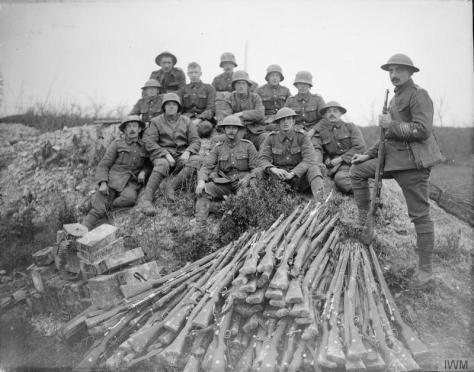 The_Battle_of_Cambrai,_November-december_1917_Q6312Men of the Sherwood Foresters (Nottinghamshire & Derbyshire Regiment) salvaging German rifles near Marcoing, 22 November 1917. First Wo