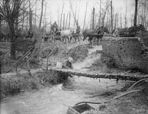 The_Battle_of_the_Somme,_July-november_1916_Battle of the Ancre. Water refilling point. The Ancre River, showing the causeway of the Mill Road, across it. Hamel-St. Divion road, November