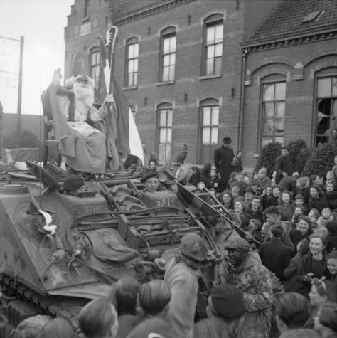 The_British_Army_in_North-west_Europe_1944-45_B12586'St Nicholas' arrives on a Sherman ARV as part of St Nicholas Day celebrations in Rucphen, near Roosendaal in Holland, 6 December 1944