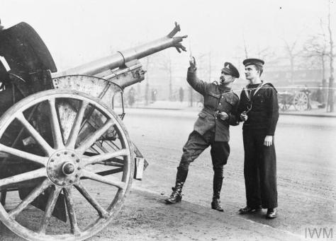 These images were taken in London in early November of 1918, as the First World War drew to a close. Captured German field guns were put on display along the Mall, stretching from Admira