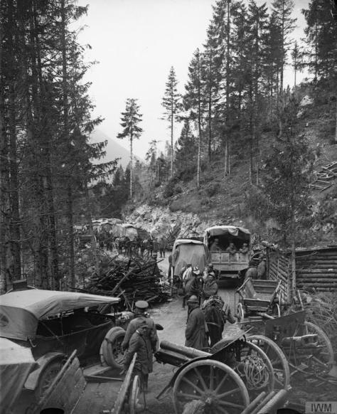 Vittorio_Veneto1918IWM British and Italian convoys passing abandoned Austro-Hungarian artillery Val d'Assa mountain road. Pass was entered by the 143rd Infantry Brigade, 48th Division, a