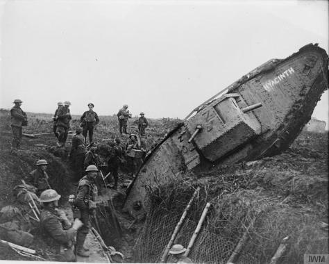 A Mark IV (Male) tank ditched in a German trench while supporting the 1st Battalion, Leicestershire Regiment, one mile west of Ribecourt. Some men of the battalion are resting in the tre