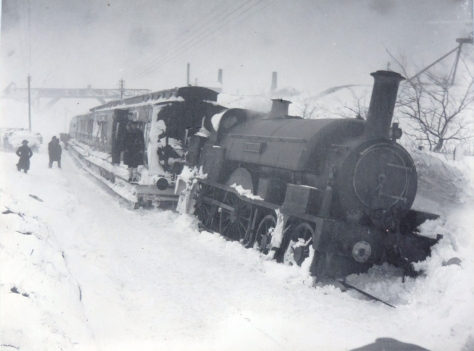 BASA-3K-7-518-56Seen here after derailing in a blizzard near Camborne, Cornwall on 8 March 1891.Great Western Railway No. 2128 Leopard (ex South Devon Railway Leopard). Victorian Era