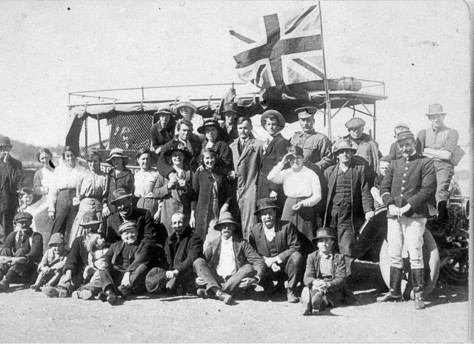 Enlisting for World War I. Recruiting Officer (beside flag ) with volunteers and their relatives and friends. Babe Cooper (second from the left of recruiting officer.) Jerseyville, NSW A