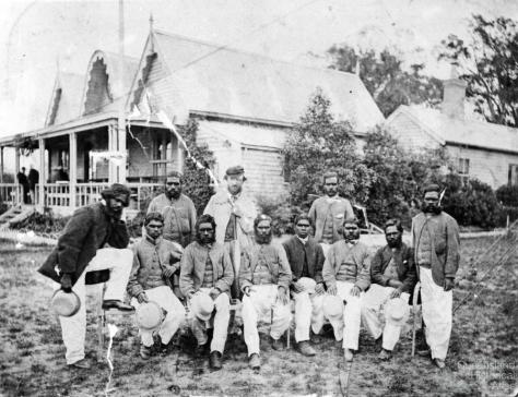 Aboriginal_cricket_team_Tom_Wills_1866 Photograph of the first Aboriginal cricket team with coach and captain Tom Wills outside the MCC pavilion of the Melbourne Cricket Ground. December