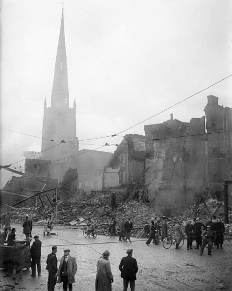 Coventry_devastation_H_5601A street in Coventry, England, after the Coventry Blitz of 14–15 November 1940. In the background are the tower and spire of Holy Trinity parish church. 16th