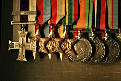 Military_cross_and_othersMilitary cross and bar, 1939-45 Star, Africa Star, Pacific Star, Defence Medal, 1939-45 War Medal and Australian Service Medal 1939-45 (L-R) - Australian War Mem