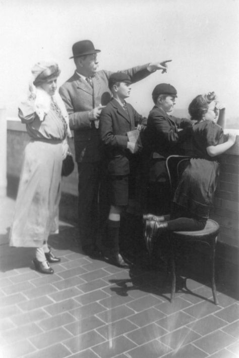 Sir_Arthur_Conan_Doyle_and_familySir Arthur Conan Doyle and family looking over wall and pointing, New York City 10th April 1922